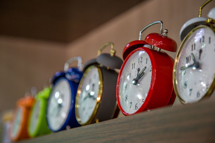 Low angle view of alarm clocks on table