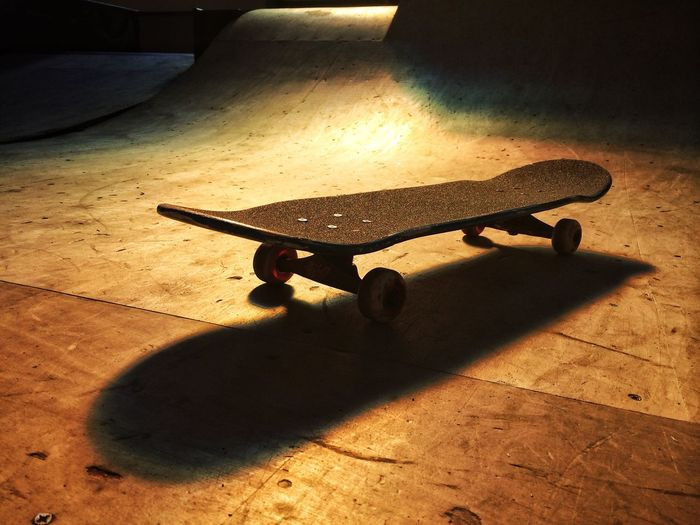High angle view of skateboard on floor at park