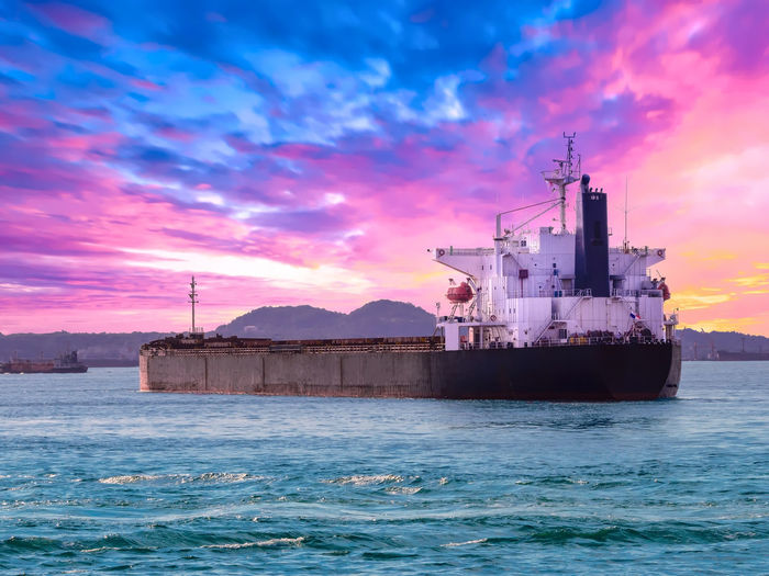 Bulk cargo vessel departure from port of thailand. Sugar Arrival Beauty In Nature Bulk Business Cloud - Sky Departure Freight Transportation Industry Mode Of Transportation Nature Nautical Vessel Outdoors Port Scenics - Nature Sea Ship Shipping  Sky Sunset Tapioca Transportation Vessels Water Woodchips