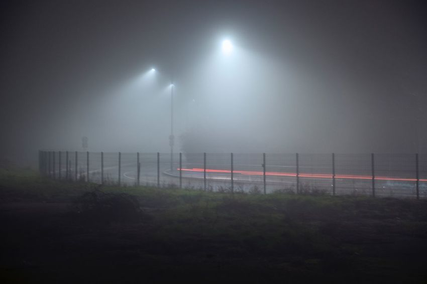 Traffic Fog EyeEm Best Shots Barrier Fence No People Boundary Night Fog Illuminated Sky Nature Environment