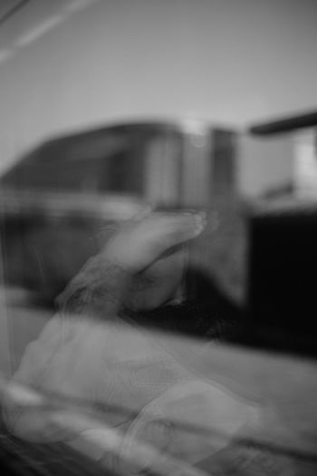 Portrait Of A Woman Street Portrait Woman Of EyeEm Blackandwhite Black And White Reflection Window One Person Indoors  Human Body Part Adult Hand Human Hand Unrecognizable Person Real People