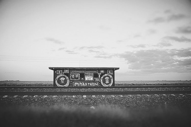 Road trip Melancholic Landscapes arts love you Best EyeEm Shot Best Eyeem Pics Melancholic Landscapes Arts Warm Light Roadtrip Road Trip Side Of Road Driving Around Railroad Track Train Tracks Graffiti Black And White Blackandwhite Remote Location One Building No People Day Outdoors Nature Sky