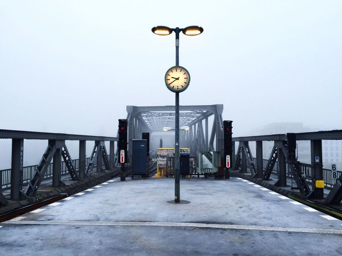 Railway Bridge Against Sky In Foggy Weather