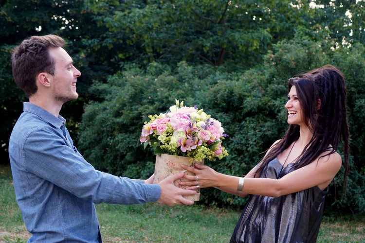 A young man gave a flower bouquet to a young woman A Young Man Gave A Flower Bouquet To A Young Woman Adult Bouquet Boyfriend Couple - Relationship Emotion Falling In Love Flower Flowering Plant Happiness Heterosexual Couple Love Men Mid Adult Mid Adult Men Outdoors People Plant Positive Emotion Side View Smiling Togetherness Two People Women Young Adult