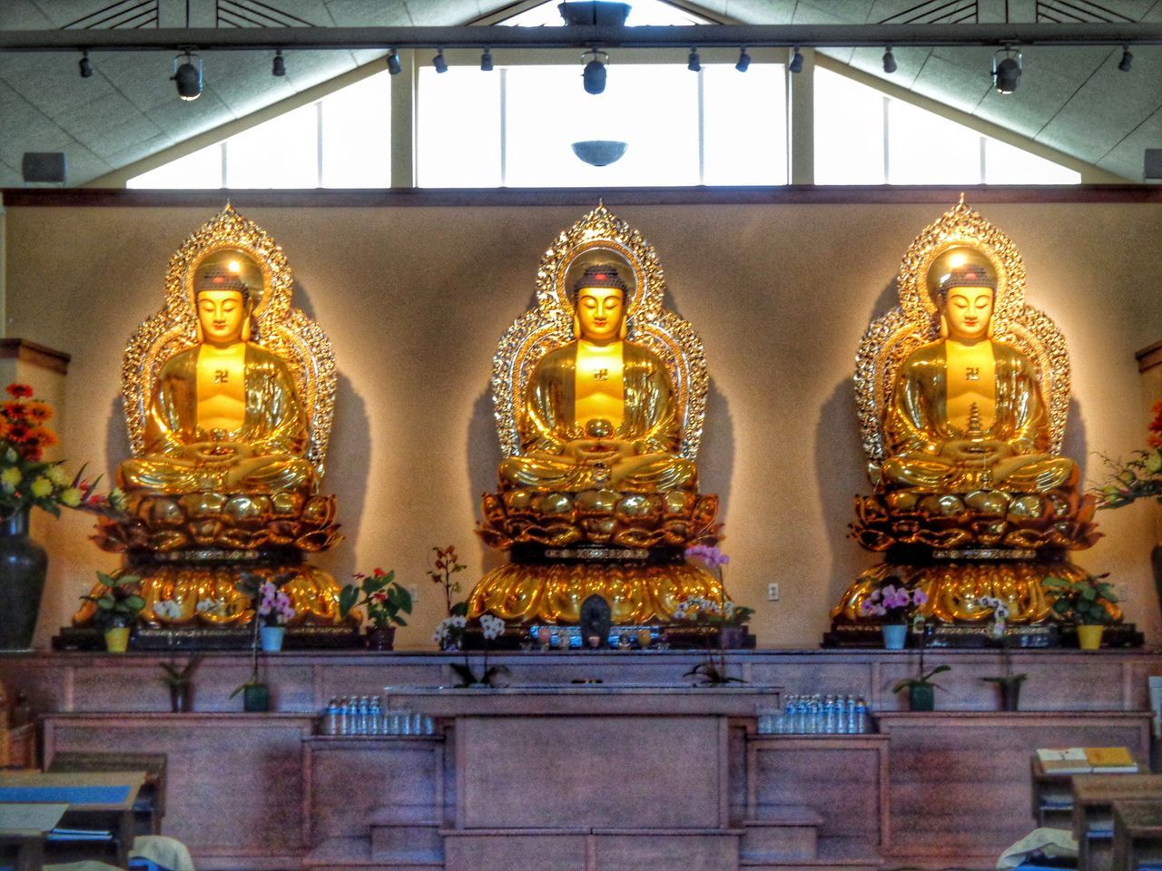 human representation, statue, male likeness, spirituality, religion, sculpture, golden color, gold colored, idol, indoors, no people, place of worship, low angle view, day