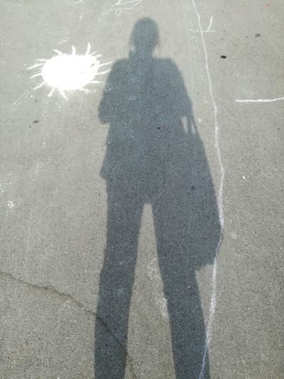 Woman Hiking Ob The Road Sun Painting Streetphotography Street Painting Shadow Shadows & Lights Shadow Photography Shadow Silhouette Focus On Shadow Long Shadow - Shadow Asphalt Hiker