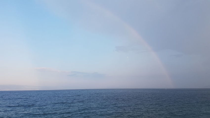 Beauty In Nature Nature Nature Photography Nature_collection Sealife Samsung Samsung Galaxy S8 Photography Regenbogen Water Sea Blue Sunset Multi Colored Refraction Pastel Colored Rippled Sky Horizon Over Water Seascape Horizon Rainbow
