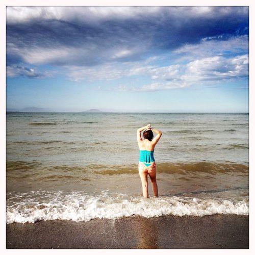 Woman standing at the Loreto Beach, Sea of Cortez, Baja California Sur, Mexico. Loreto Baja California Sur Mexico Beach Woman Sea Beach Resort Vacation Tourism Relaxation