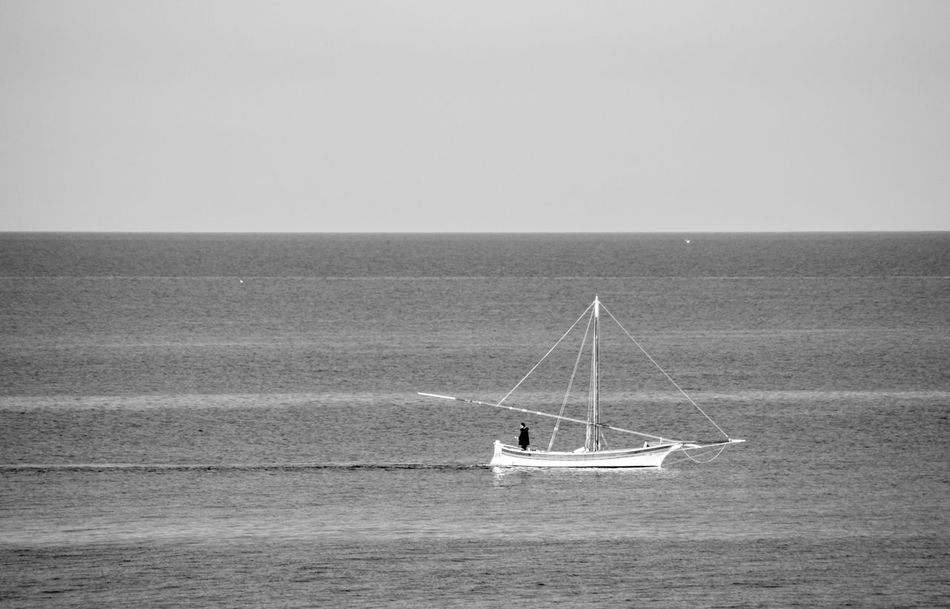 Alone Time Blackandwhite EyeEm Best Shots EyeEm Nature Lover Eyeem Photography Horizon Over Water Sea And Sky Tranquil Scene Water EyeEmBestPicslandscapes Monochromatic Monochrome Photography Monochrome Relaxing View Tranquil Scene Outdoors Boating Boat Fishing Boat Fishing Time Alone In The Sea