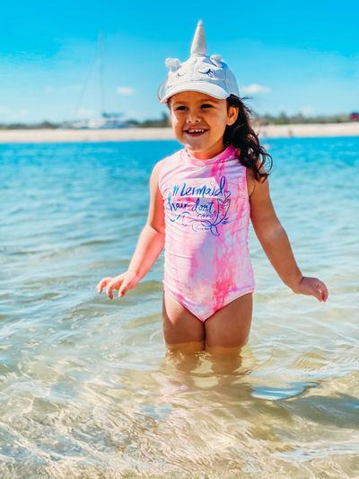 Full length of a girl smiling at beach