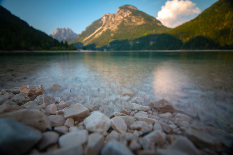 Lago di Predil in friuli julian veneto, italy EyeEm Best Shots EyeEm Nature Lover Beauty In Nature Day Idyllic Italy Lake Mountain Mountain Peak Mountain Range Nature No People Outdoors Pebble Rock Rock - Object Scenics - Nature Sky Solid Stone Stone - Object Surface Level Tranquil Scene Tranquility Water