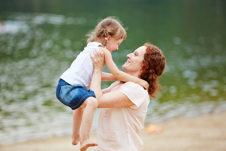 woman with daughter in lake Affection Arm Beach Bonding Carry Casual Clothing Child Childhood Closeness Daughter Emotion Family Family Holidays Family With One Child Females Fun Girl Girls Hairstyle Hand Happy Holiday Innocence Joy Joyful Lake Leisure Leisure Activity Lifestyle Lift Up Love Luck Mother Outdoors Outside Parent Parents People Play Positive Positive Emotion Real People Relationship Sea Smile Spring Summer Summer Holidays Togetherness Travel Vacation Water Woman Women Young