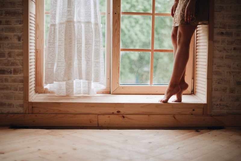 young girl trying on a dress Window Indoors  One Person Curtain Home Interior Day Human Body Part Sunlight Standing Domestic Room Wood Body Part Flooring Hardwood Floor Adult Glass - Material Lifestyles Wood - Material Nature Apartment