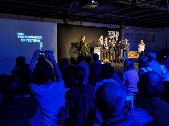 Announcing the photographer of the year! Real People Adult Men Lifestyles BPW18 Eyeemawards2018 Eyeemawards18 EyeEm Team Festival EyeEmFestival Arts Culture And Entertainment Illuminated Indoors  Large Group Of People Crowd Night Enjoyment Stage - Performance Space Communication
