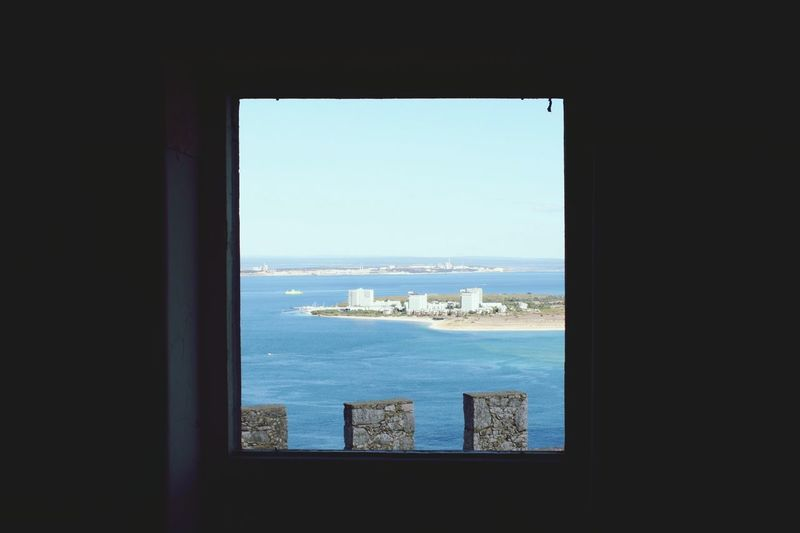 Troia on the window Troia Troia Portugal Setubal Window Window View Sea Window Water Indoors  Horizon Over Water Blue Built Structure Architecture Nautical Vessel Door City Building Exterior Sky Cruise Ship Day Nature Scenics Distant Harbor Coastline
