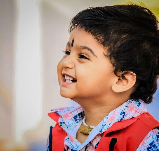 Close-Up Of Cute Boy At Home