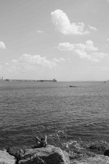 """part of """"Tales of Istanbul"""". The Sea. I'll add soon the full gallery at ivandimarcophotography.com Check This Out Relaxing Streetphotography Blackandwhite Vertical Streetphoto_bw B&w Street Photography Ivandimarcophotography City People Sea Seascape Sea And Sky Everybodystreet Summer Water Outdoors Digital Tranquility Fujifilm Distant Escapism Tranquil Scene Getting Away From It All 35mm Lens"""