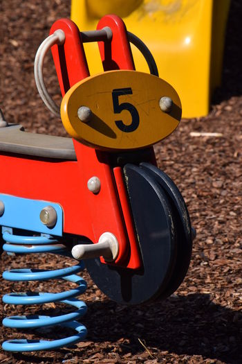 Toys at a children's playground Blue Children's Place Close-up Colourful Day Five Focus On Foreground Man Made Object No People Orange Color Outdoor Outdoor Photography Outdoors Playground Red Red