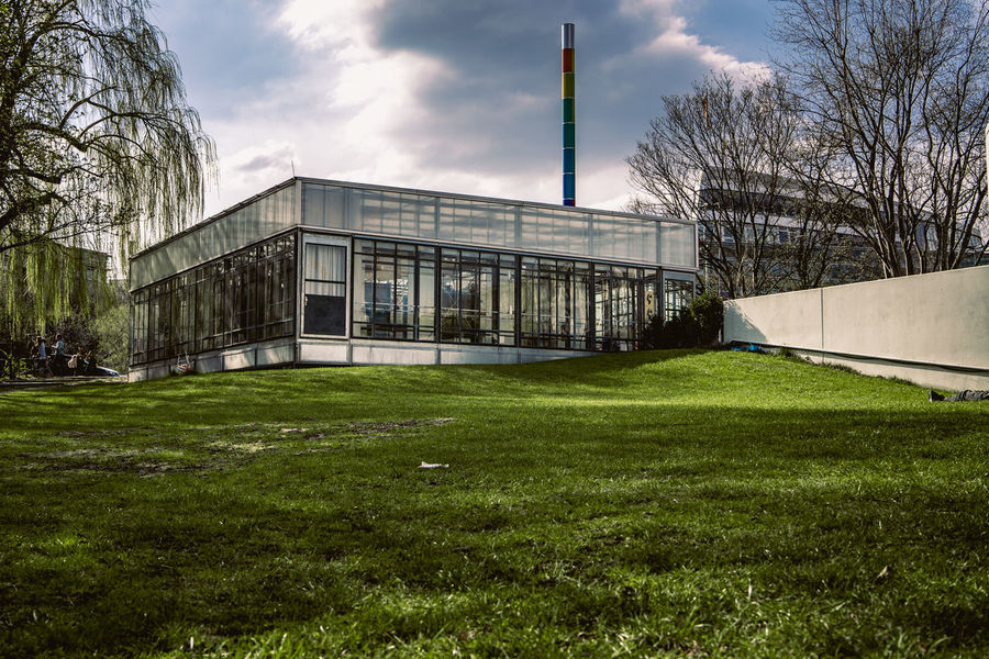Bauhaus Archives Bauhaus Bauhaus Building Bauhaus Museum Bauhaus Architecture Bauhaus Style Architecture Bare Tree Building Building Exterior Built Structure Cloud - Sky Day Education Factory Field Grass Green Color Industry Land Nature No People Outdoors Plant Sky Tree