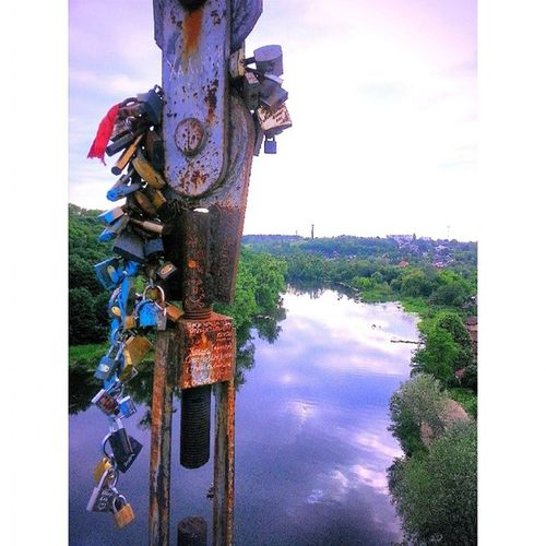 Locks hanging from the bridge over the Teteriv River in Zhytomyr, Ukraine. Teteriv Zhytomyr Ukraine Vscocam vsco vscophile vh_water locks lockit instanocrop