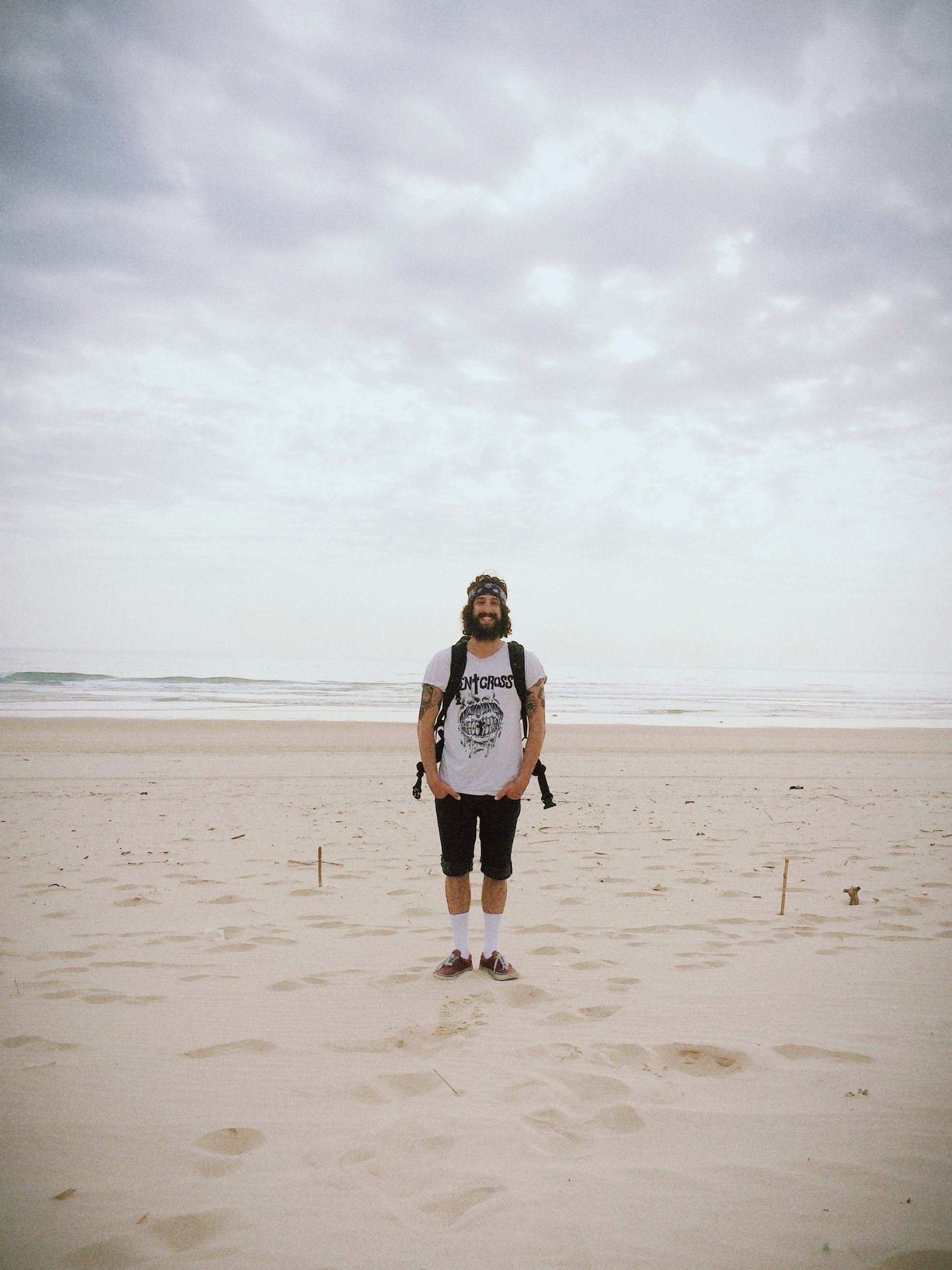 beach, sand, sea, sky, shore, horizon over water, rear view, full length, lifestyles, leisure activity, tranquility, walking, tranquil scene, person, cloud - sky, casual clothing, vacations, scenics