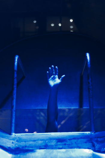 Close-up of hands in illuminated room