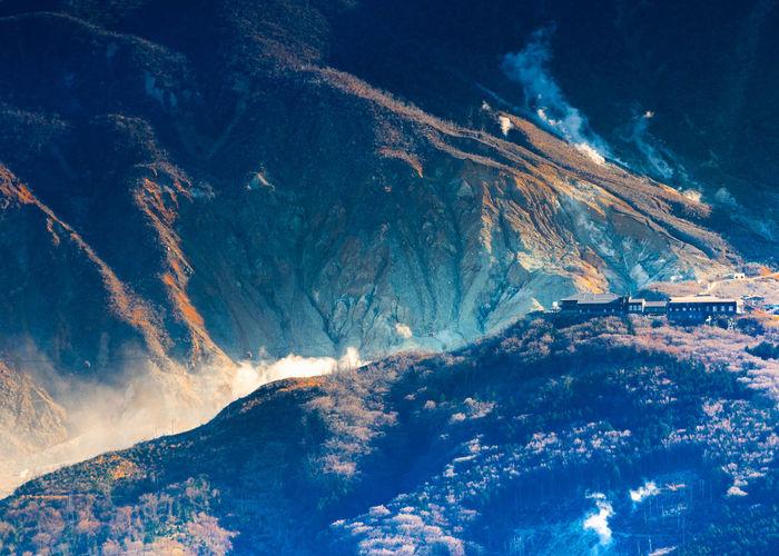 View from peak of kintokiyama of owakudani where  sulfur gases are escaping in hakone, japan.