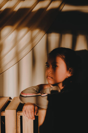 Portrait of girl looking away at home