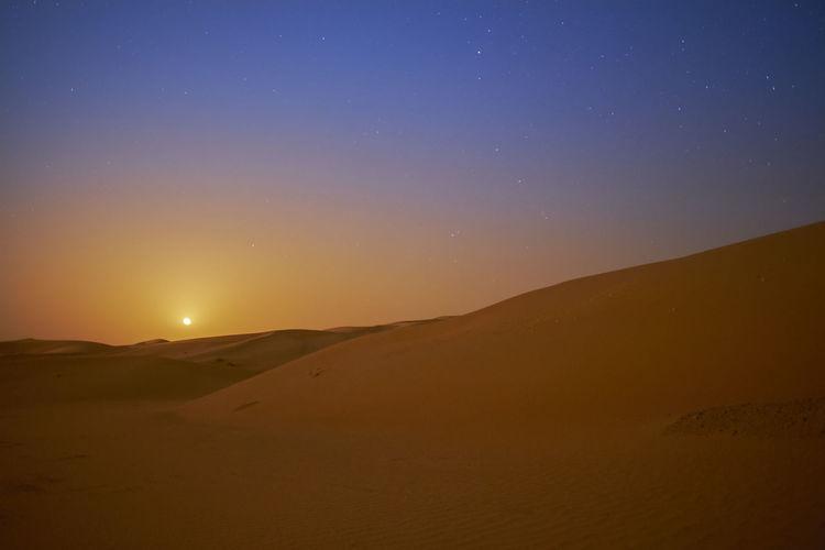 Qasr Al Sarab Desert Resort, Abu Dhabi Abu Dhabi Desert Dunes Moon Qasr Al Sarab Astronomy Beauty In Nature Desert Landscape Long Exposure Night Rising Moon Sand Sand Dune Scenics - Nature Star - Space Stars The Great Outdoors - 2018 EyeEm Awards HUAWEI Photo Award: After Dark