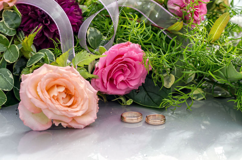 Flower decoration and a ring set on gray wedding car bonnet. Beauty Beauty In Nature Bouquet Close-up Day Flower Flower Head Fragility Freshness Gold Growth Indoors  Nature No People Peony  Petal Pink Color Plant Rings Rose - Flower Wedding