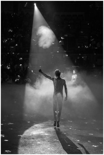 In The Spotlight Black And White Friday Blackandwhite Photography Circusartist Circusimages Full Length Illuminated Men Monochrome Photography One Person Real People Spotlightonartists Standing