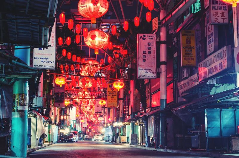Street decorated with paper lanterns at night