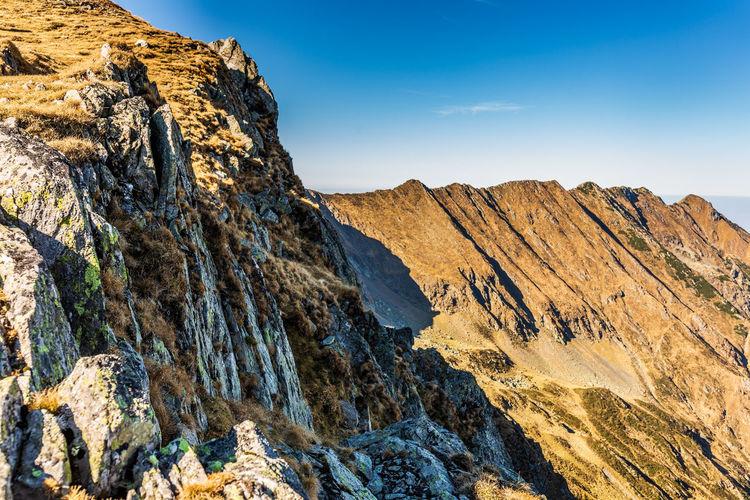 Landscape with rocky mountain peaks in summertime season, fagaras mountains, romania