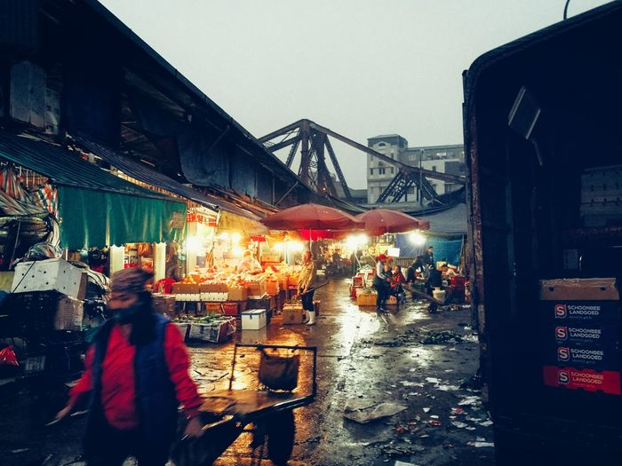 Come back home from fruite night market Long Bien Bridge Fruite Night Market Rain Wet Night Weather City Sky Outdoors