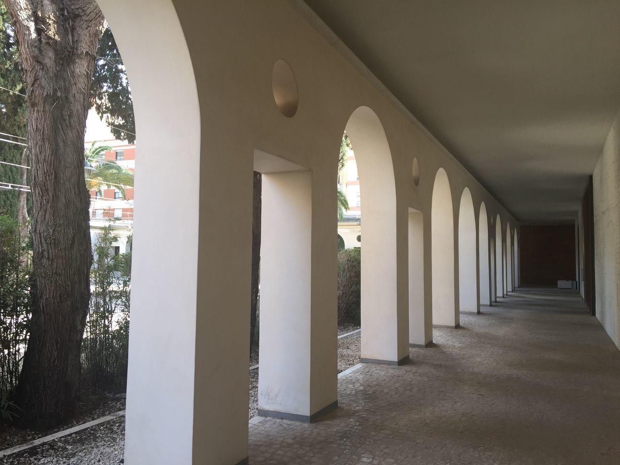 CORRIDOR OF BUILDING WITH COLONNADE