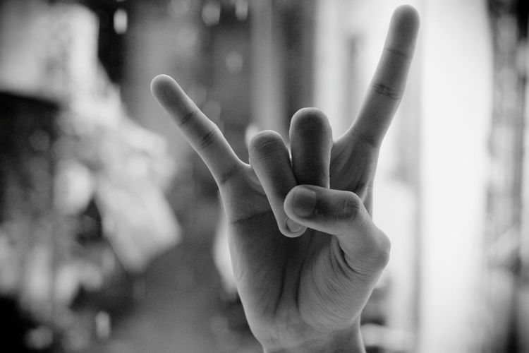 Cropped Hand Showing Rock Sign