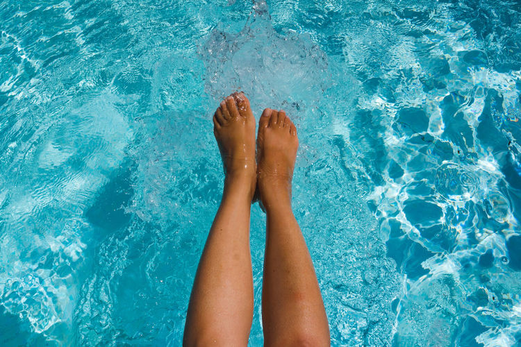 Female legs in the water. Low Section Water Swimming Pool Women Relaxation Summer Human Leg Young Women Blue Leg Foot Poolside Toe Sun Lounger Pool Party Deck Chair Lounge Chair Pool Toenail Human Feet Feet