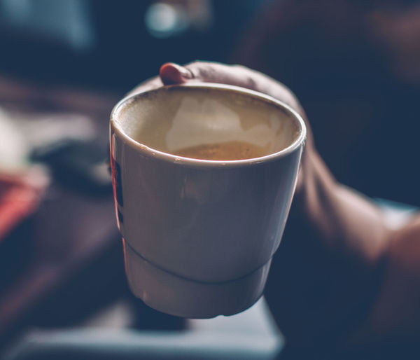 Female holding a coffee mug in hand. Drink Coffee - Drink Coffee Cup Food And Drink Indoors  Close-up Frothy Drink Human Hand Coffee Mug Expresso  Food Stories Visual Creativity