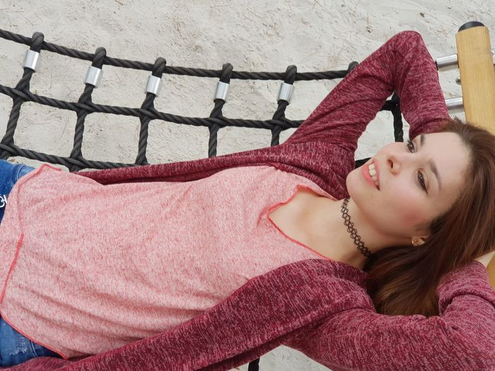 High angle view of woman lying on hammock at playground