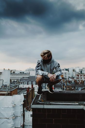 City Cityscape Colors Exploring London Rooftop Streetwear The Street Photographer - 2018 EyeEm Awards Architecture Building Exterior Built Structure City Cloud - Sky Clouds Day Explore Off White Off White C/o Virgil Abloh One Person Outdoors Portrait Sky Sunset Young Adult The Fashion Photographer - 2018 EyeEm Awards