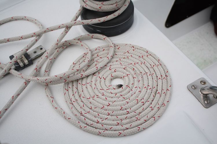 EyeEm Selects Rope Catamaran Sailing Ocean White Color Coiled Rope Coiled up rope on deck of a catamaran