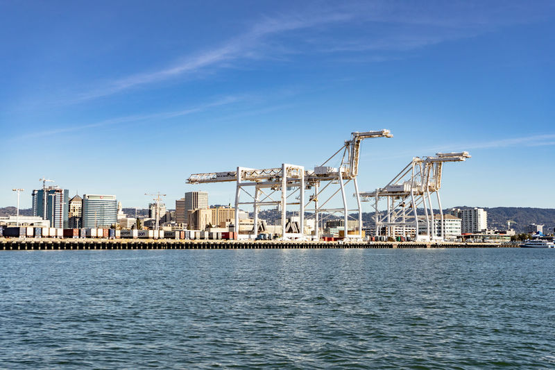 Water Waterfront Sky Architecture Industry Machinery Nature Crane - Construction Machinery Day Sea Business No People Blue Built Structure Transportation Building Exterior City Outdoors Nautical Vessel Construction Equipment Oakland