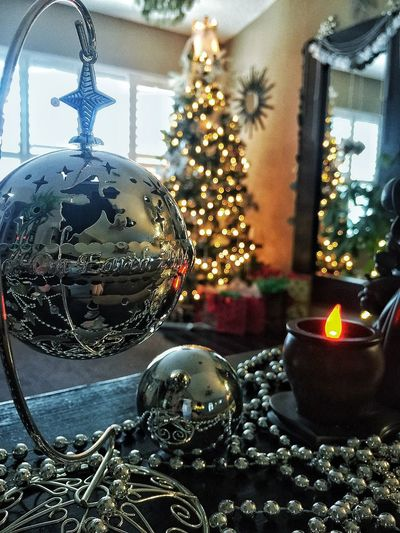 Christmas Christmas Decoration Celebration Christmas Ornament Christmas Tree Decoration Tradition Holiday - Event Indoors  Silver Colored Illuminated Close-up No People Bauble Christmas Lights Day
