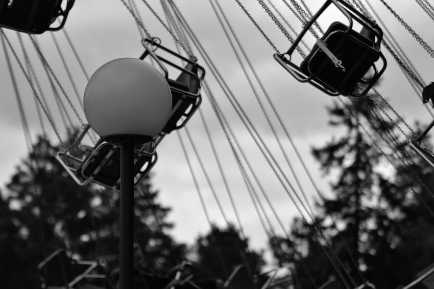 Lamppost Lamp Post Summer Seat Black And White Summer Low Angle View Sky Focus On Foreground Amusement Park Ride Amusement Park Nature No People Built Structure Outdoors Architecture Plant Hanging Cable Connection Chain Swing Ride Day Technology Arts Culture And Entertainment The Still Life Photographer - 2018 EyeEm Awards The Street Photographer - 2018 EyeEm Awards The Architect - 2018 EyeEm Awards