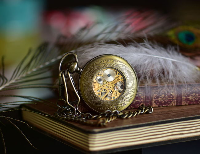 Close-up of vintage clock on table