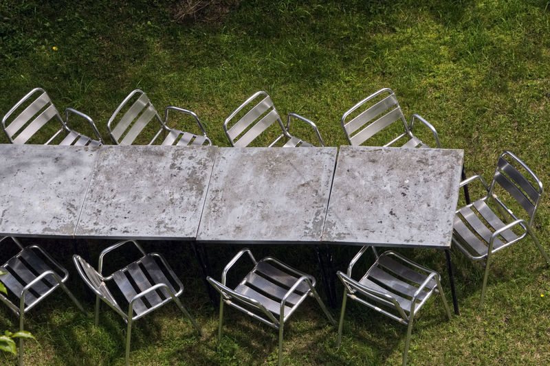 High angle view of empty chairs in yard