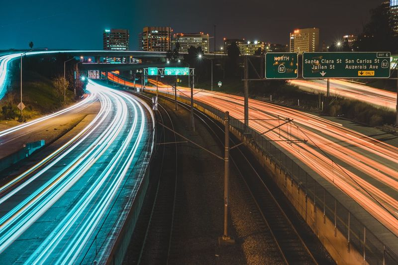 High angle view of light trails on multiple lane highway at night