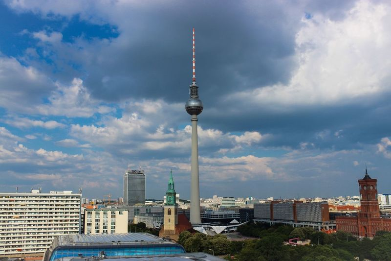 Fernsehturm Against Cloudy Sky In City