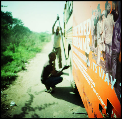 Fixing and Sleeping on a bus in Westafrica Analogue Photography Avaria Lomography Mali Rest In Bus Roadkill Warndreieck WestAfrica Accident Adventure Africa Bus Accident Bus In Africa Inside A Bus La La Land Medium Format Repairing A Bus Road Accident Roadsign Roadtrip Sleeper Sleeping In Bus Sleeping On Roadtrip Vintage Bus Xpro