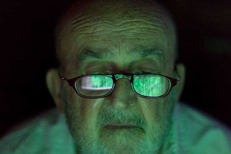 old man looking at a hacked computer screen Darkness Green Color Reflection Screen Security Beard Black Background Close-up Computer Concerned Confused Cyber Data Despair Digital Eyeglasses  Front View Hacked Headshot Mature Adult Monitor Portrait Senior Men Staring Stressed